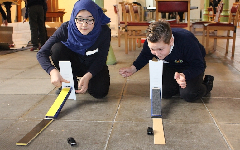 Physics in action at a community project supported by the Trust. Two children investigate forces.