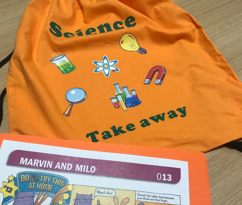 The science take away bag and a Marvin and Milo card